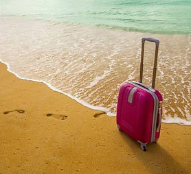 24387984-suitcase-on-the-beach.jpg