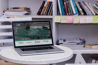 A laptop displaying web site of Entomak