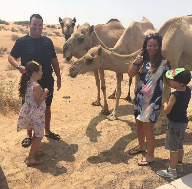 Billy, Madison, Wife Monique and Billy (the son) feeding the camels
