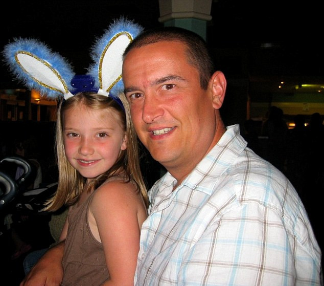 British businessman Jonathan Nash (pictured with his young daughter) was jailed for 37 years in Qatar for a bounced cheque has admitted: 'I may never see my family again'
