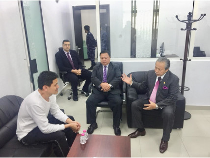 Richard Lau meets the Malaysian Foreign Minister before his release.