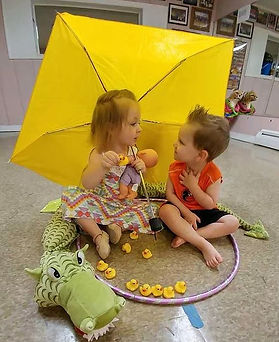 Our Move with Me friends are in a world of their own under the big yellow umbrella with ducks!