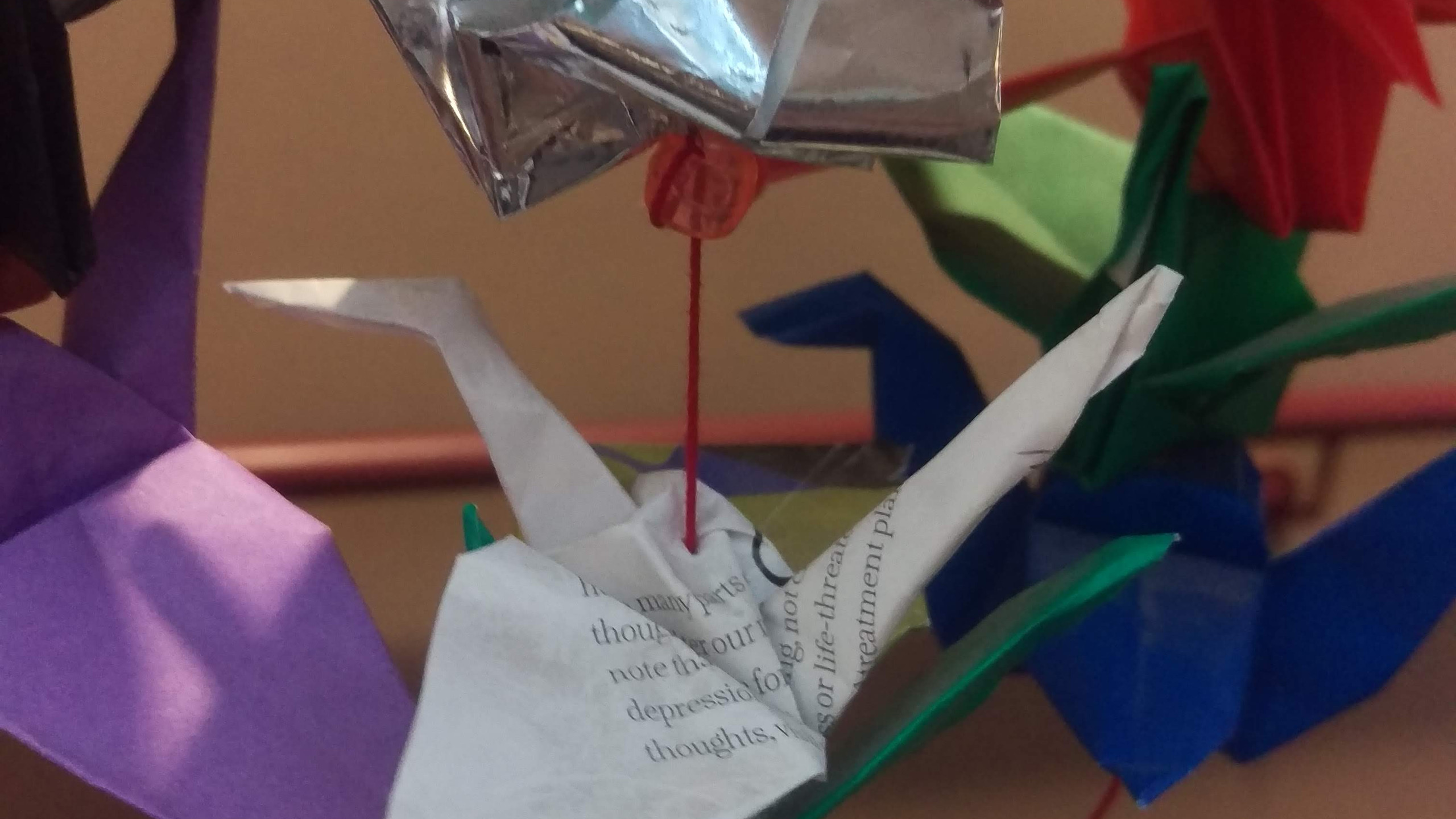 Reused book pages and gum wrapper paper cranes.
