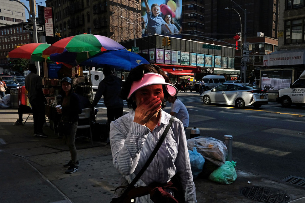 Chinese woman covering her face