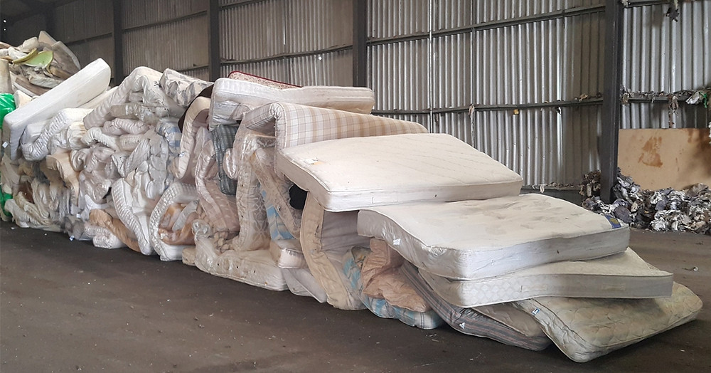 Pile of mattresses awaiting recycling