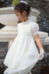 Girl outdoors with short sleeve organdy dress and mesh gloves