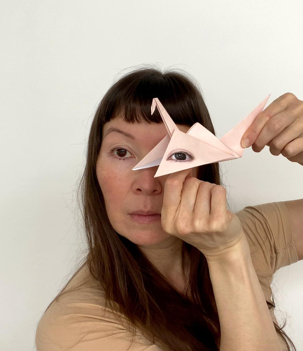 Self Portrait with Origami Crane #4.jpeg