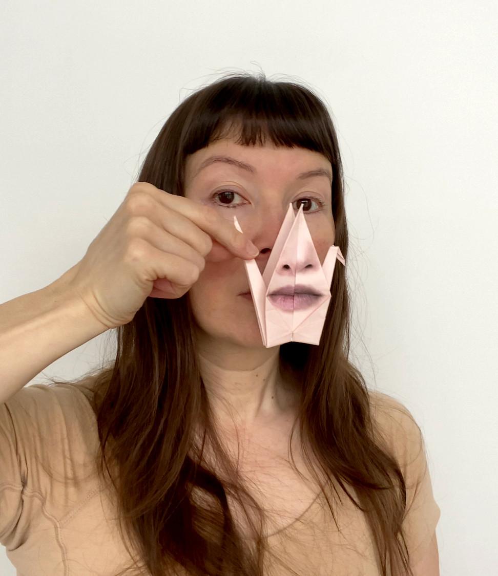 Self Portrait with Origami Crane #1.jpeg