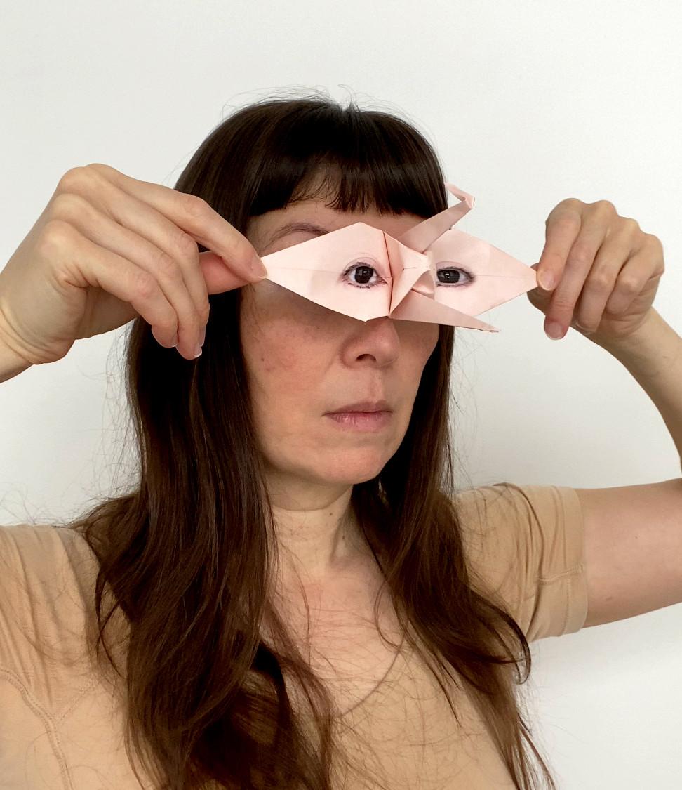Self Portrait with Origami Crane #3.jpeg
