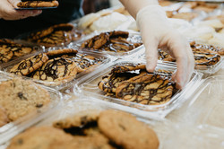 Carefully packaging cookies.