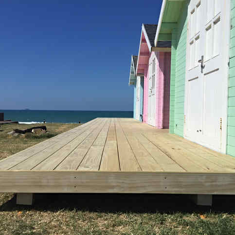 Woooden Decking on pastel beach garages by Tim Scrimshaw at Coast Build, Gisborne, NZ