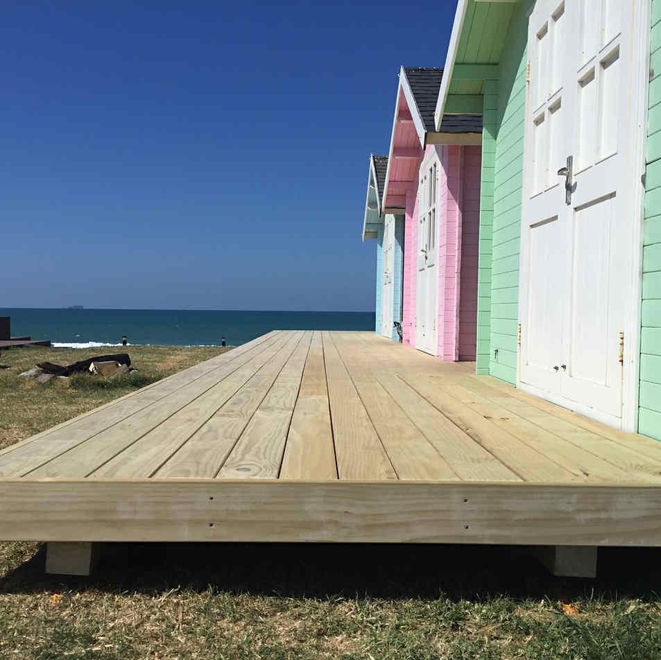 Woooden Decking on pastel beach garages by Tim Scrimshaw at Coast Build, Gisborne, NZ