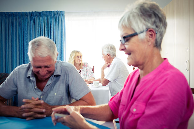 Group of seniors playing cards in the retirement house.jpg