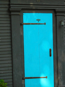 bright blue door with large hinges