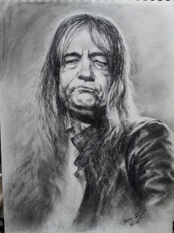 Charcoal study of Cristian Minculesco, Romanian rock singer. Reference photo courtesy of www.portrai