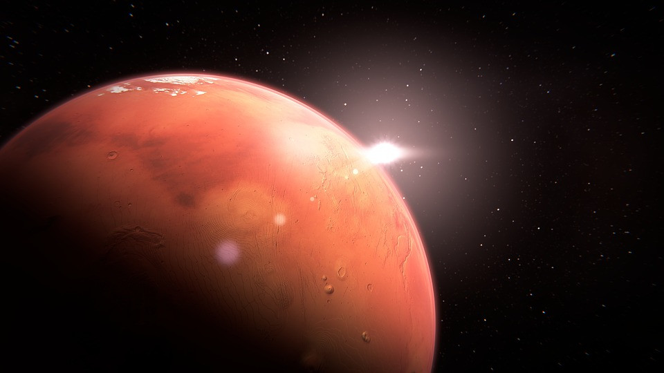 Mars in lower left corner with solar flare - Rotundus Mental Health Blog