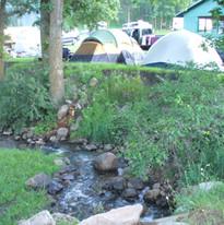 tents along creek.JPG