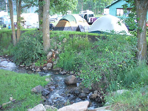 Tent sites along creek at Spokane Creek Cabins & Campground