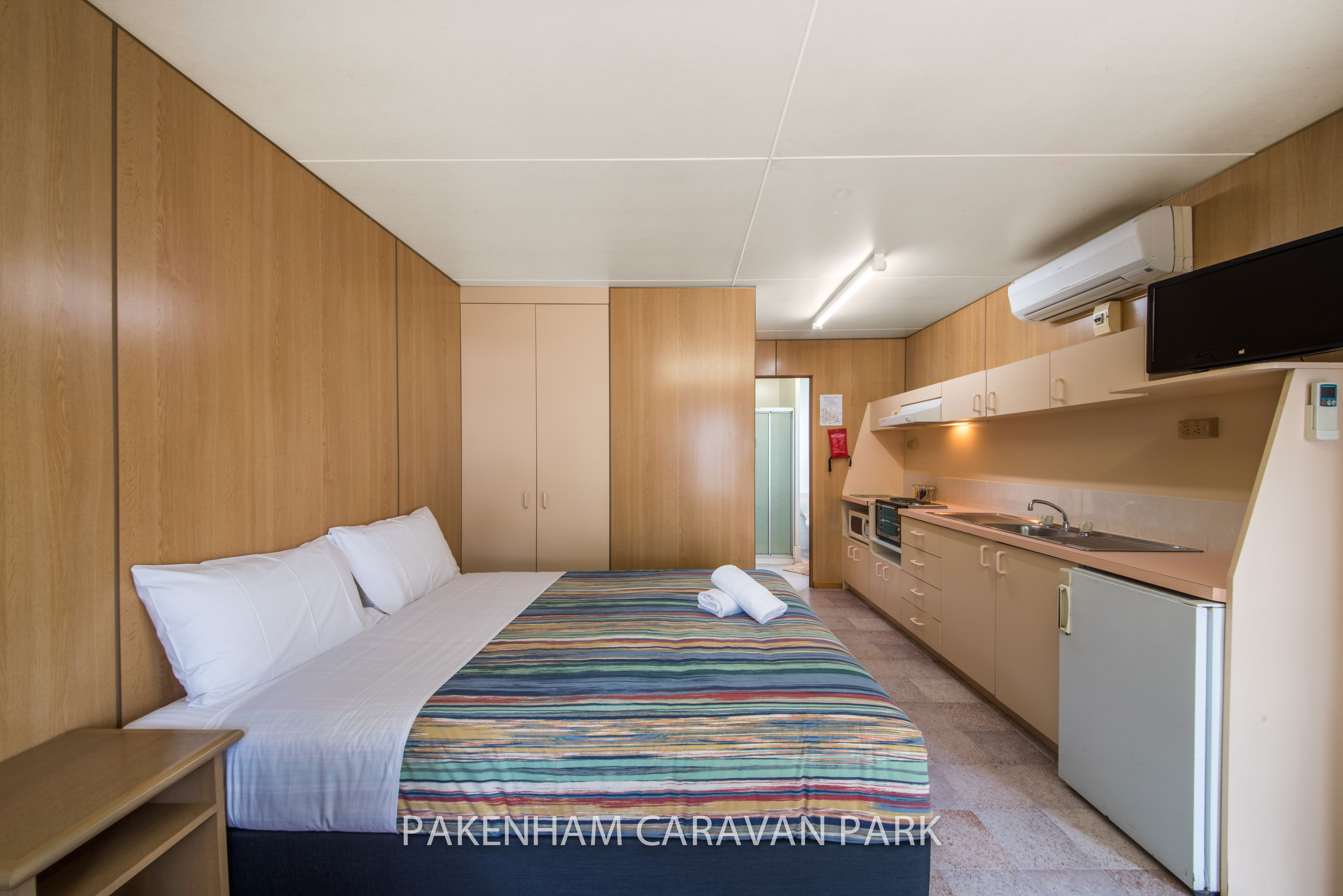 standard cabin, bed and kitchen