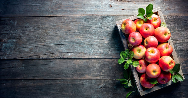 Ripe Apples In Wooden Basket On The Rust