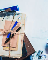 stack-of-drafts-pencil-boxes-and-papers-