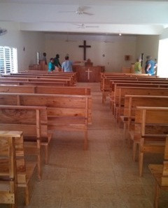 Members of Iglesia Santo Tomas are helping move the twenty-five new pews into the sanctuary of Iglesia Santo Tomas.