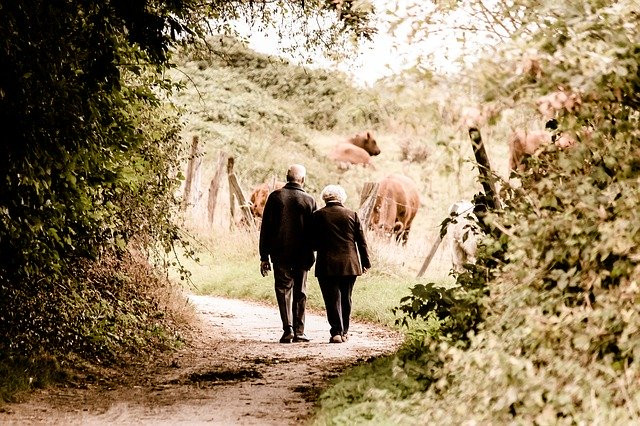 old couple linking arms