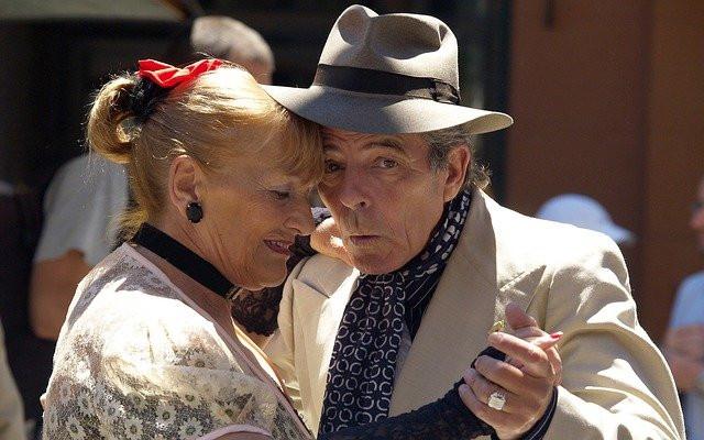 Older couple having fun dancing