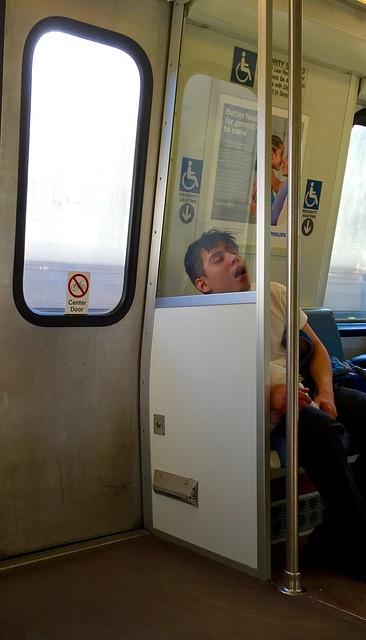 Teenage lad asleep on a train — Source — Pixabay