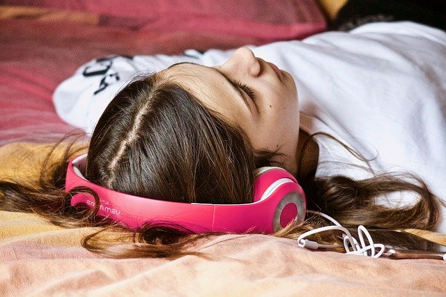 Teenager listening to music — Source — Pixabay