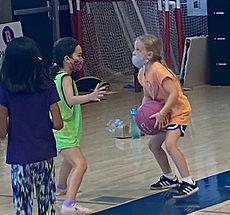 shoter girl shooting a basketball summer 2021.jpg