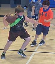 boy dribbling basketball summer 2021.jpg