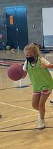 girl dribbling basketball summer 2021.jpg