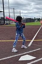 Kelsey swining bat Summer 2021.jpg