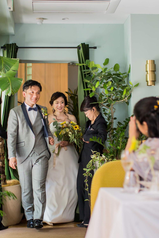 日比谷パレスで結婚式をした新郎新婦の披露宴入場を撮影した写真
