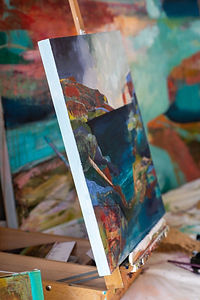 alix painting on easel.jpg