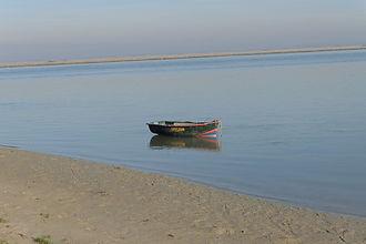 Artiste de l'éphémère, la Baie de Somme avec ses couleurs, ses lumières et la mer. Barque à marée montante