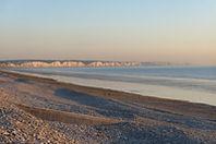 Coucher de soleil sur les falaises et les galets de la réserve naturelle du Hâble d'Ault au sud de la Baie de Somme