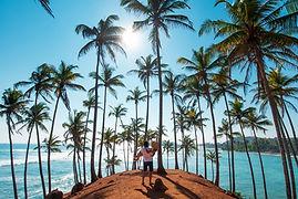 Loving couple at Coconut tree hill in Mi