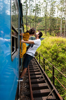 Couple kissing on a blue train ride in S