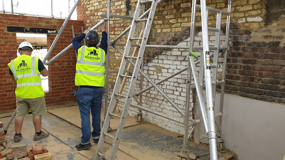 AIA Building Contractors builders setting up scaffolding on loft conversion in Hackney, E1