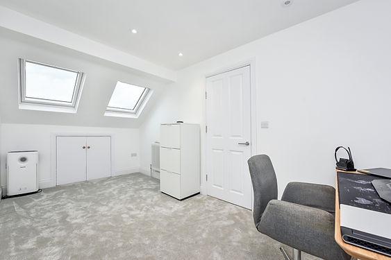 Our team of experienced loft conversion specialists can turn your unused attic space into an extra bedroom with clever space-saving solutions such as a fitted wardrobe or a staircase with built-in chest of drawers.