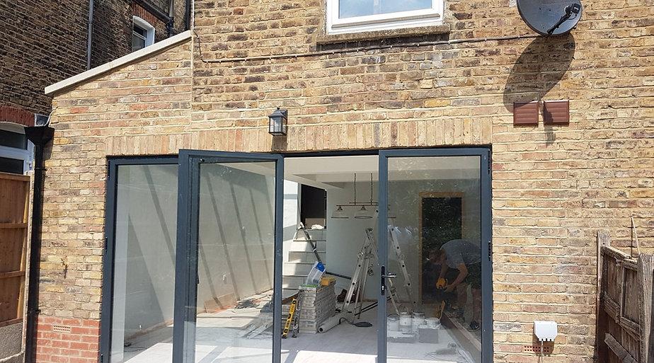 Exterior of Ground floor extension with bifolding glass aluminium doors