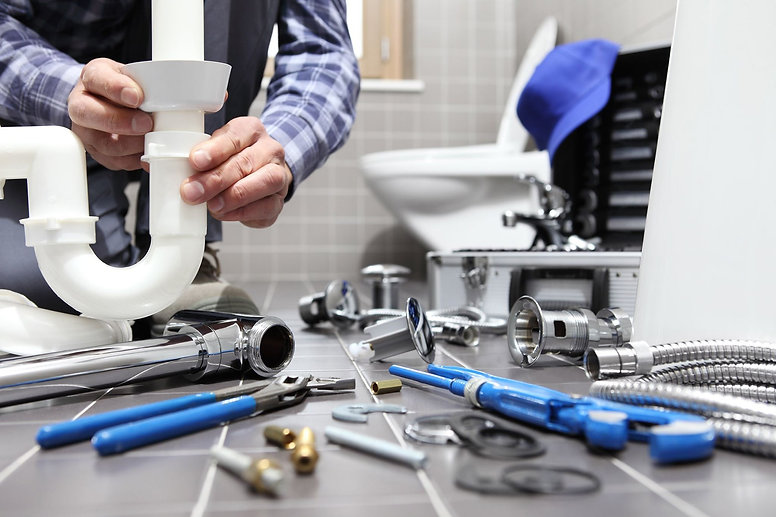 plumber at work in a bathroom, plumbing repair service, assemble and install in north london