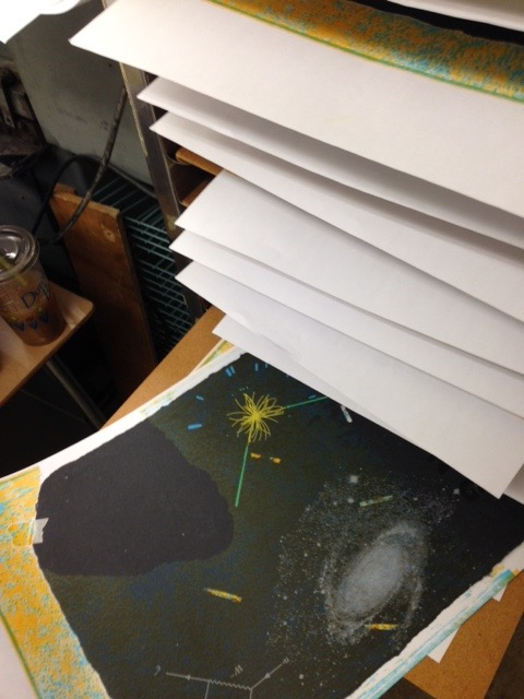 Stack of drying prints.