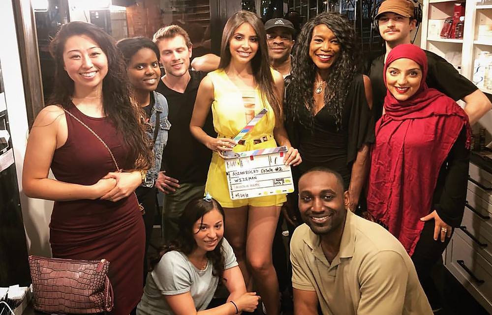 """Park (L) would like to thank the diverse """"Asian Rocks"""" team. Khensu is seen at the bottom (R). Former Miss Puerto Rico, Catalina Morales joins the cast and crew at the series premiere screening."""