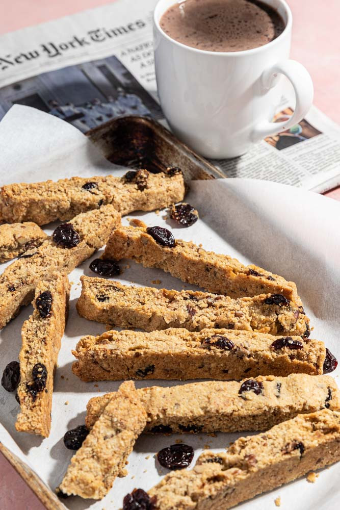 Food photography cherry biscotti with hot coffee and newspaper
