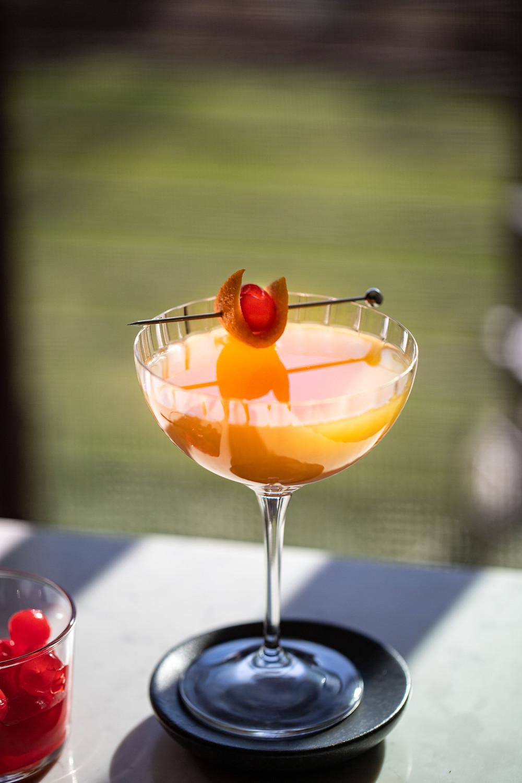Amaretto Whiskey Cocktail with Cherry and Orange Garnish