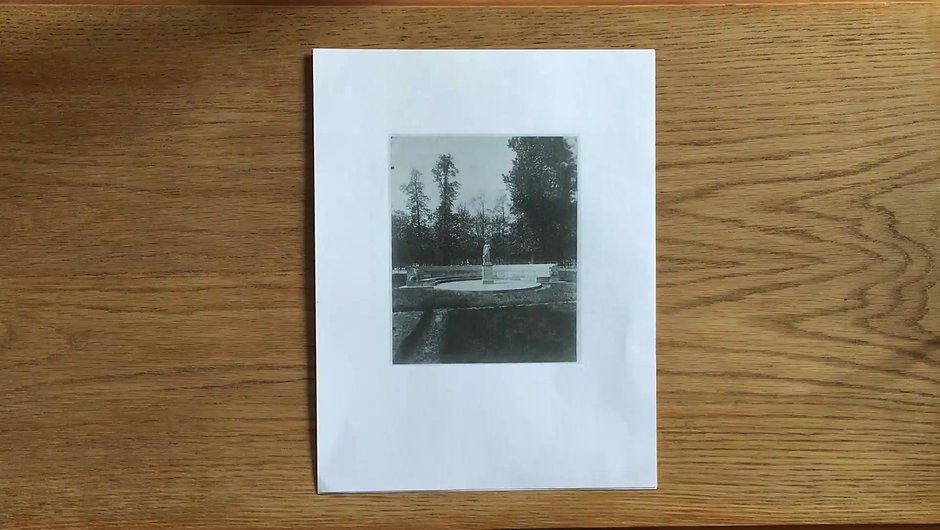 A real-time handwritten reading of two photographs.