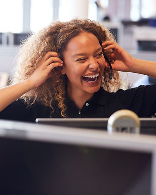 laughing-businesswoman-wearing-telephone